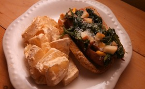 Apple chicken sausage served with sauteed apples and spinach - topped with fresh parmesan.